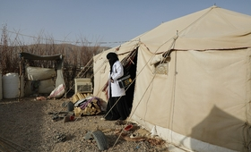 A reproductive health worker exits a tent in a displacement camp where she is providing services. UNFPA is the sole provider of life-saving reproductive health services in Yemen. © UNFPA Yemen