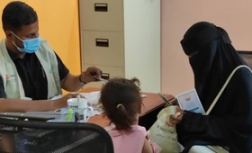 Hala receiving her identification documents at the safe space. © UNFPA Yemen